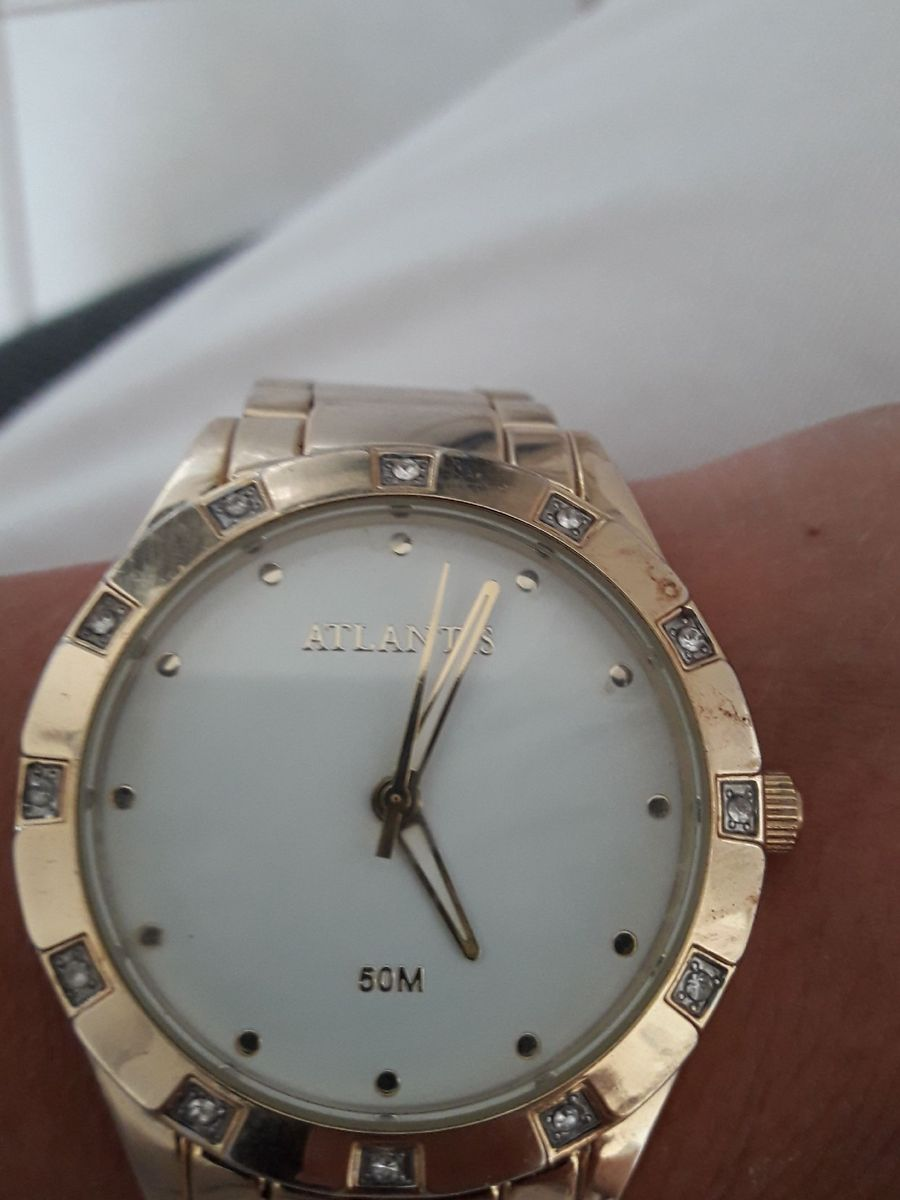 ba65261fe4 relógio feminino dourado fundo branco marca atlantis - relógios atlantis