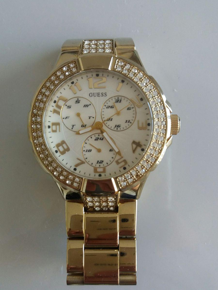 1a2f2e0ae17 relógio guess dourado feminino - relógios guess.  Czm6ly9wag90b3muzw5qb2vplmnvbs5ici9wcm9kdwn0cy81njm0otu2l2zjnjjknzq4ywrkmdkzzmnlyjewnji3y2yxmgnmnwq4lmpwzw
