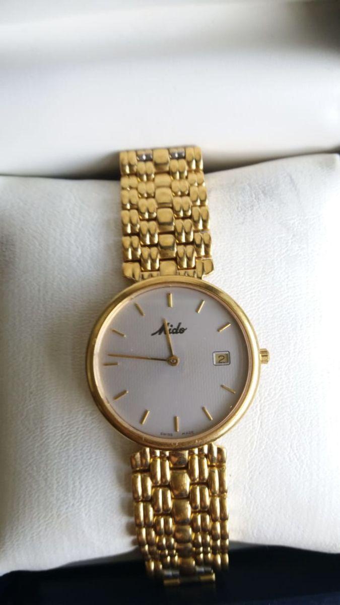 cead82e20d2 relogio mido de pulso em ouro - relógios mido.  Czm6ly9wag90b3muzw5qb2vplmnvbs5ici9wcm9kdwn0cy8xmdexmzyzns8zndlimmqxmwq0mtkxzgjjn2m0ymm3ytixywqzowi3yi5qcgc  ...