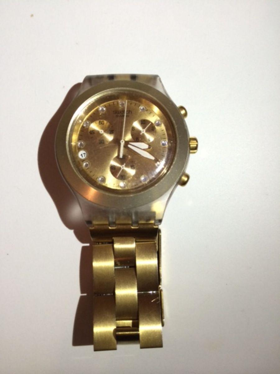 10e363293c9 relógio swatch swiss dourado - relógios swatch.  Czm6ly9wag90b3muzw5qb2vplmnvbs5ici9wcm9kdwn0cy80njcwodgvmzvjyjczmweyytfim2i0nmy4ztbhmmnjmtu2mji1m2euanbn  ...