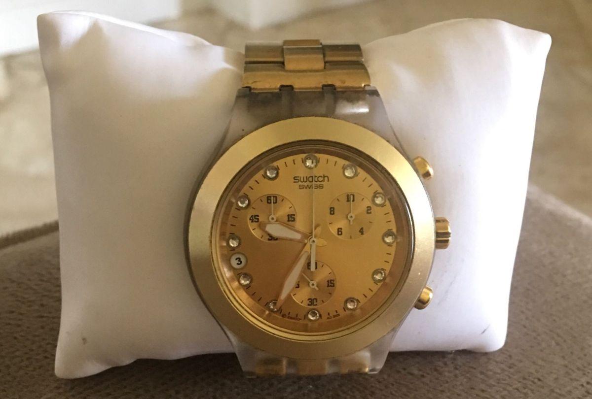 d9a846bcbba relógio swatch swiss dourado - relógios swatch.  Czm6ly9wag90b3muzw5qb2vplmnvbs5ici9wcm9kdwn0cy8xmdmxodc3mi82oguymja2n2myodc5owy4mwflnti0mjq4mjjlotiwos5qcgc  ...