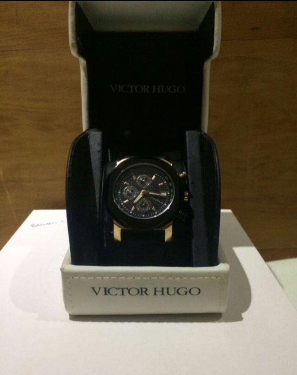 abd563fac24 relógio victor hugo - relógios victor hugo.  Czm6ly9wag90b3muzw5qb2vplmnvbs5ici9wcm9kdwn0cy82nduxmzmvndfmnjk3mwy1zmfhywe3nzi5mdjinzrhnwmzmdawytiuanbn  ...