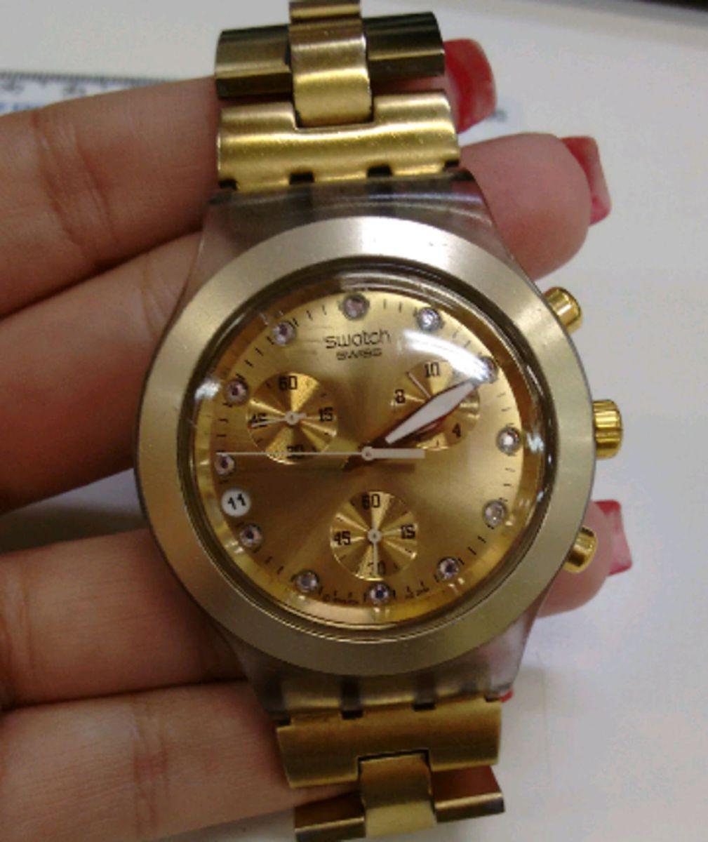 dd0cb56efb1 swatch série ouro - relógios swatch.  Czm6ly9wag90b3muzw5qb2vplmnvbs5ici9wcm9kdwn0cy82mjk4mjuzl2uyn2nlm2nindbimzm0zmrmywm1zda5ndu2mzzhywmxlmpwzw  ...