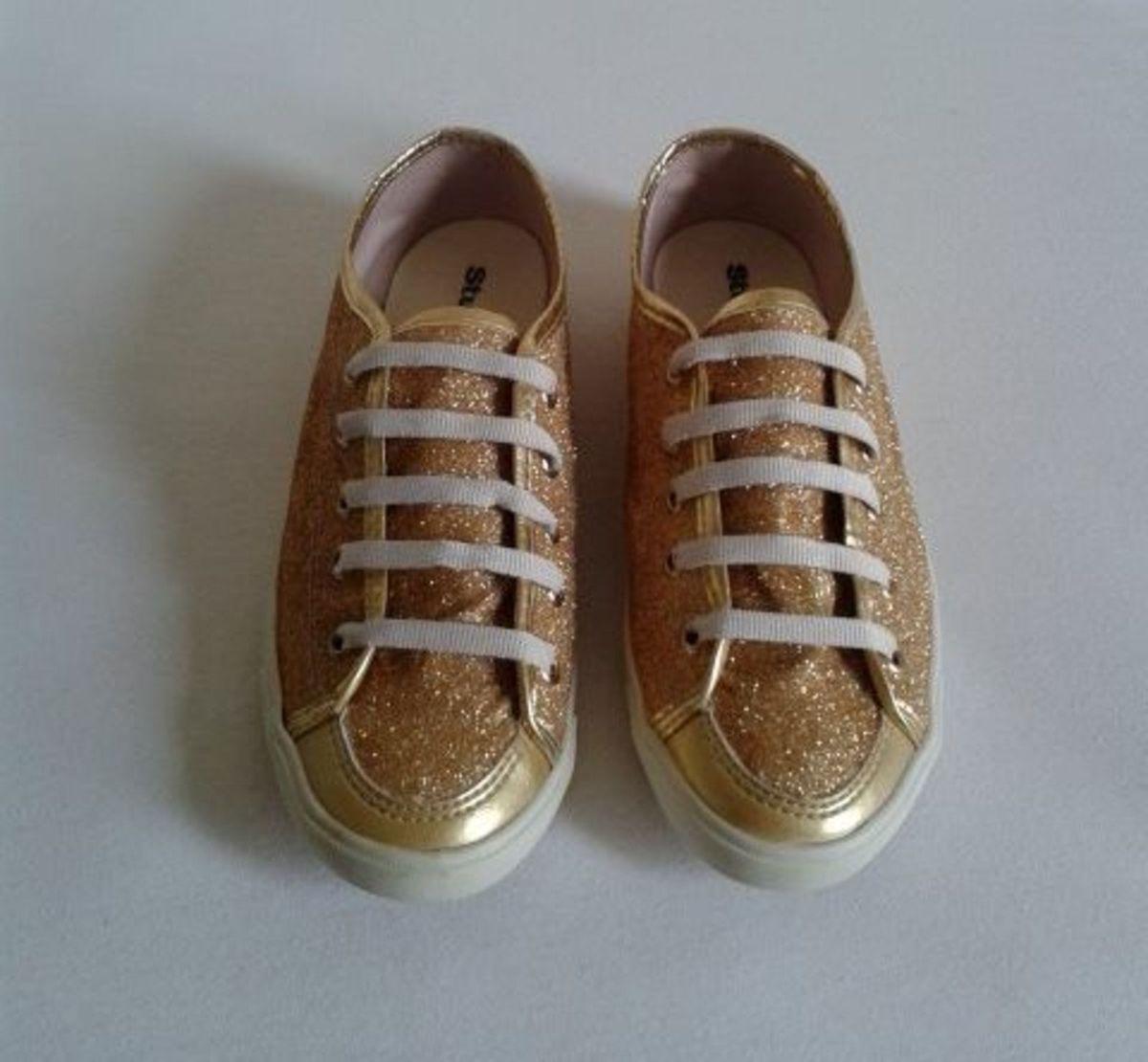 0eec4789b8 tênis glitter dourado - tênis studio z.  Czm6ly9wag90b3muzw5qb2vplmnvbs5ici9wcm9kdwn0cy8ymtqyos9hm2yyothkmdy1mdjkywy0mgviotjmztkzymfjmjk4oc5qcgc